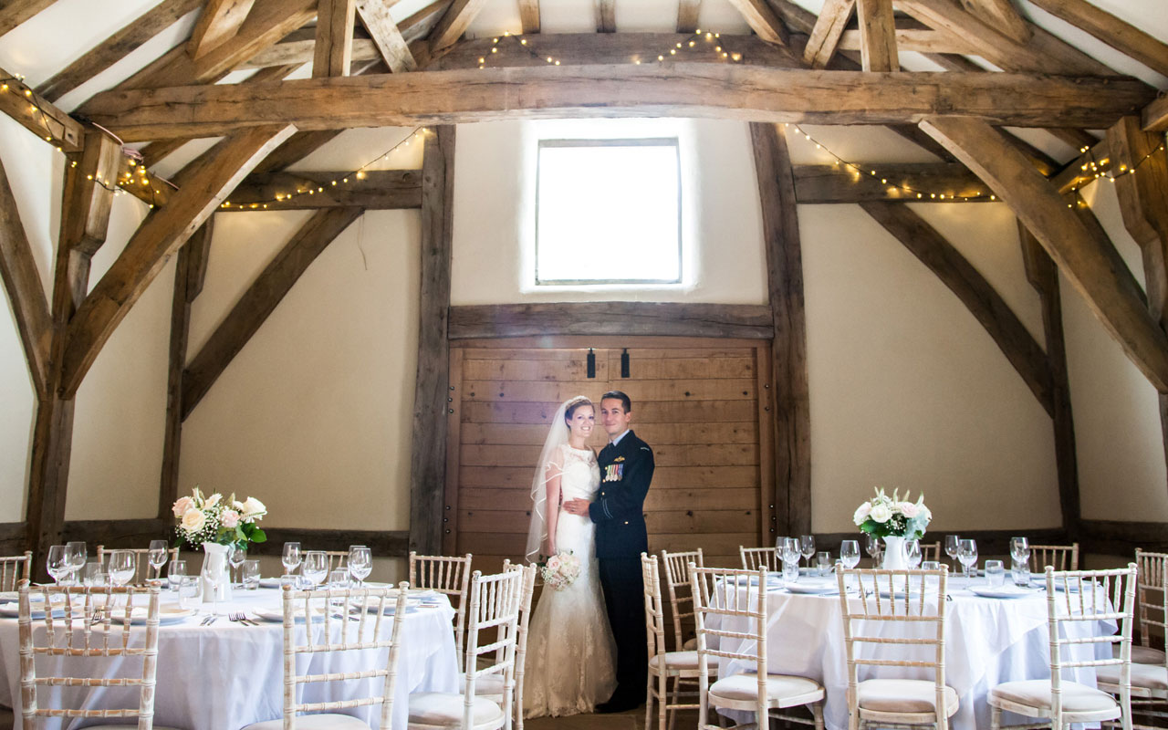 Barn with couple under twinkling fairy lights