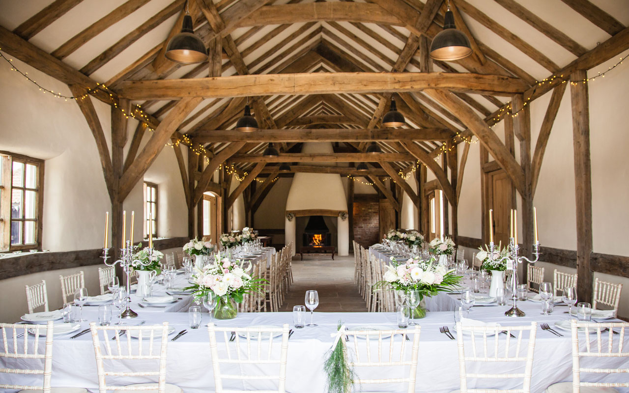 Barn with tressle tables and fireplace