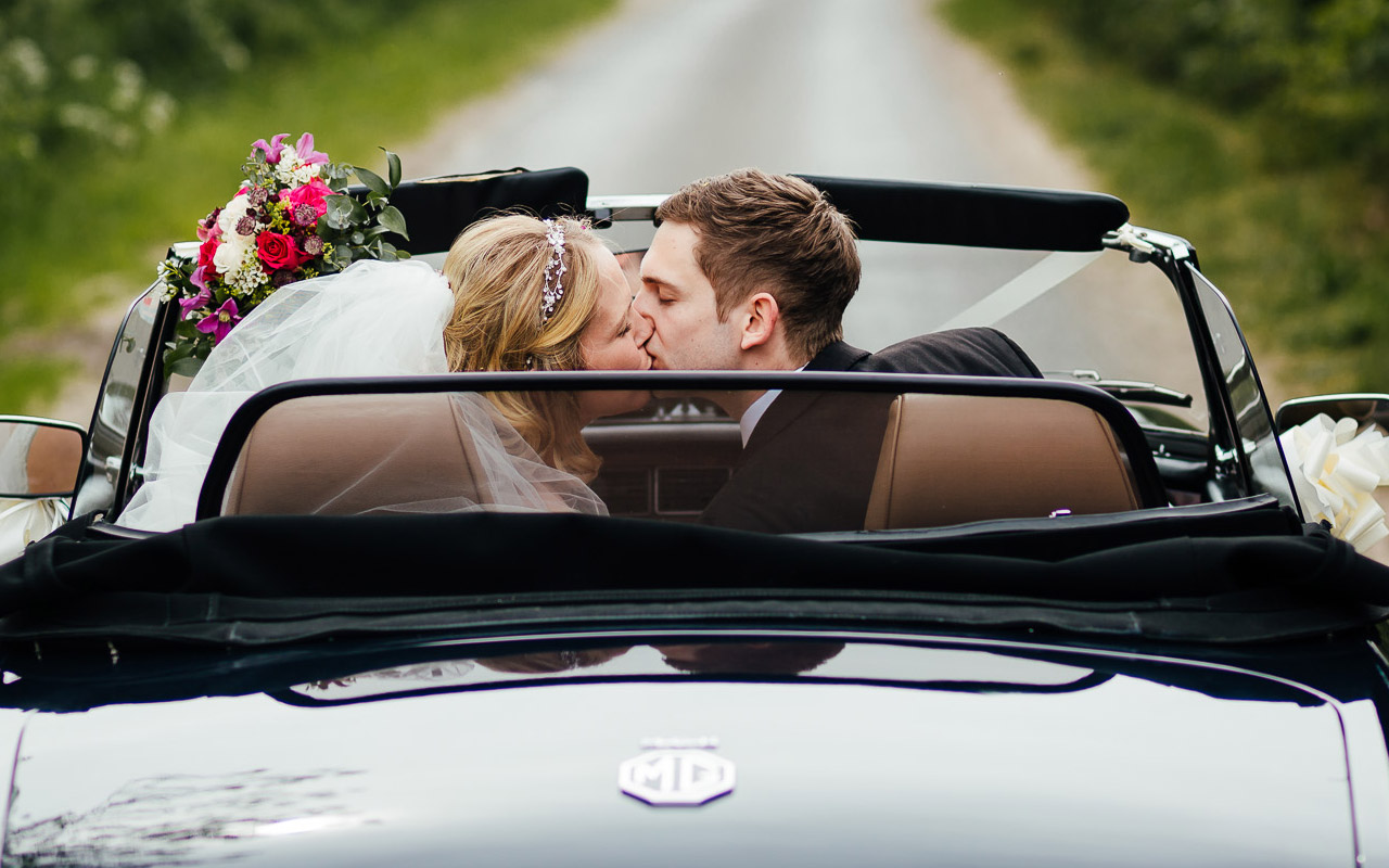 Happy couple in an MG